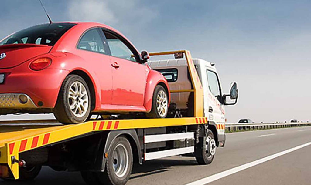 How to properly handle a roadside car breakdown and obtain towing services?